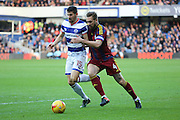 Queens Park Rangers midfielder Pawel Wszolek (15) battles for possesion with Ipswich Town defender Luke Chambers (4) during the EFL Sky Bet Championship match between Queens Park Rangers and Ipswich Town at the Loftus Road Stadium, London, England on 2 January 2017. Photo by Matthew Redman.