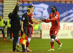 Cardiff City's Kenwyne Jones (R) is substituted for Alex Revell - Photo mandatory by-line: Richard Martin-Roberts/JMP - Mobile: 07966 386802 - 24/02/2015 - SPORT - Football - Wigan - DW Stadium - Wigan Athletic v Cardiff City - Sky Bet Championship