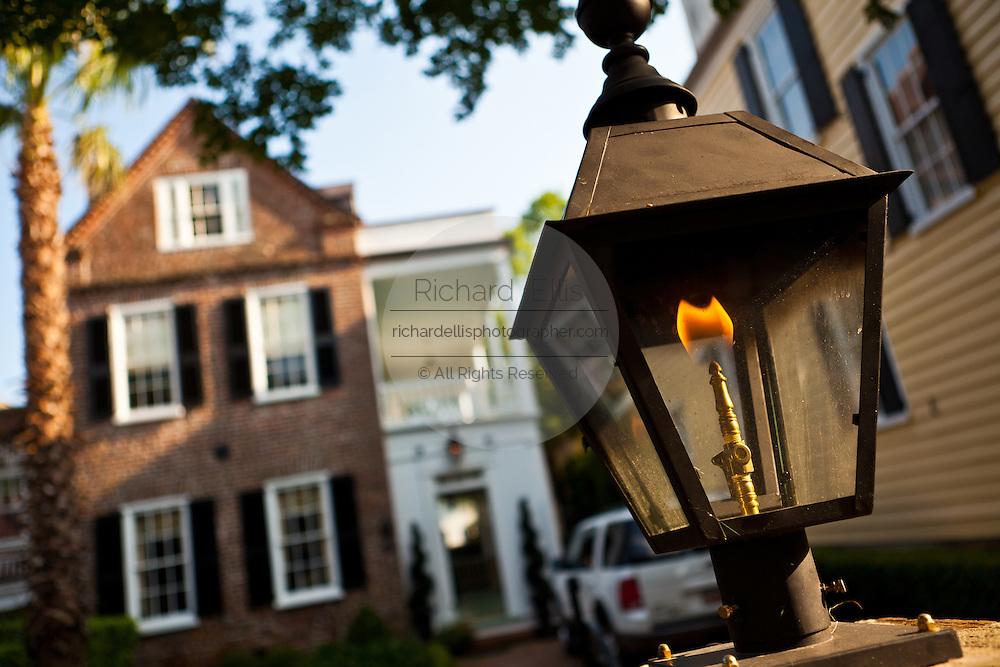 Gas lantern outside a historic Charleston Single style home in Charleston, SC.