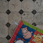 A toddlers play mat on the floor at Villa Artemis, a shelter for 30 refugee women and their children in the grounds of Leros Hospital. <br />