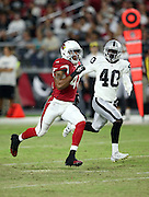 Arizona Cardinals rookie defensive back Trevon Hartfield (41) runs down field while being shadowed by Oakland Raiders defensive back rookie Kenneth Durden (40) during the 2016 NFL preseason football game against the Oakland Raiders on Friday, Aug. 12, 2016 in Glendale, Ariz. The Raiders won the game 31-10. (©Paul Anthony Spinelli)