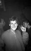 Smoking man during a rave, High Wycombe, UK, 1980s.