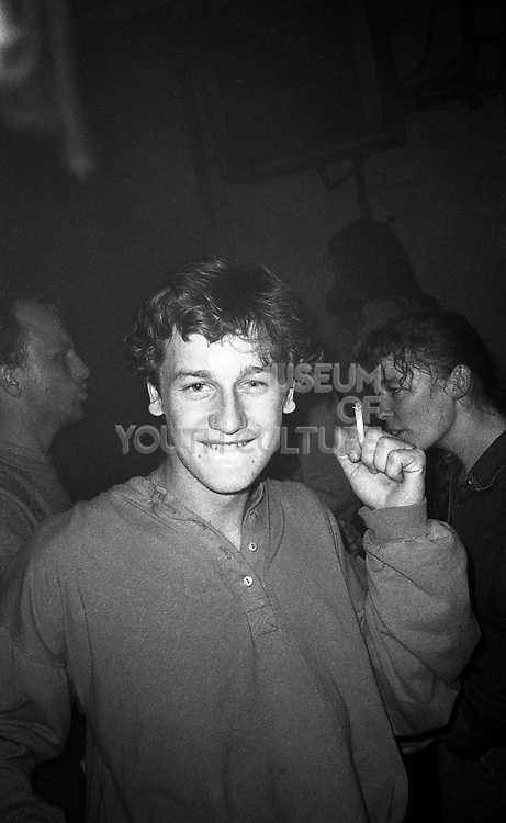 Smoking man during a rave, High Wycombe, UK, 1980s.