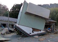 London News Pictures. 20/03/2011. In Onagawa, Japan, a house is flipped onto its roof by the force of the wave that hit the town. Thousands are missing after a 9.0 magnitude strong earthquake struck on March 11 off the coast of Japan causing a tsunami wave. Photo credit should read Alex Tee/London News Pictures.