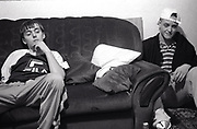 Two teenage boys lounging at home Newport South Wales