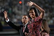 DENVER, CO - August 28, 2008:  Democratic Presidential nominee Barack Obama and Michelle Obama on stage following Obama's acceptance speech on the final night the 2008 Democratic National Convention at Invesco Field in Denver, Colorado.