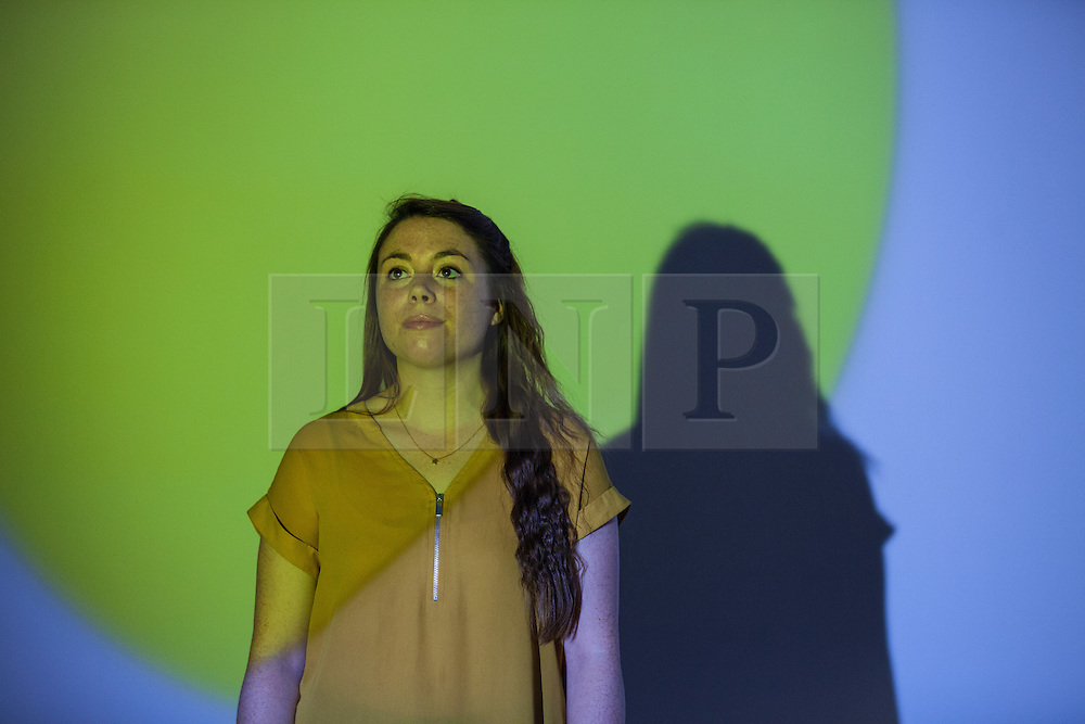 © Licensed to London News Pictures. 14/06/2016. London, UK. A young woman walks through a light installation at the Tate Modern gallery in London. The gallery's new ten-storey extension, the Switch House, includes the world's first gallery space dedicated exclusively to live art, film and installations and opens to the public on Friday 17 June 2016. Photo credit: Rob Pinney/LNP