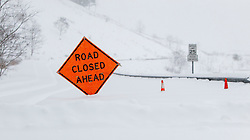 Saturday, Jan. 22, 2016: A road closed sign is seen on Emmett Drive in Morgantown, W.Va. after Winter Storm Jonas ripped through North Central West Virginia and dumped nearly 18 inches of snow. (Photo by Ben Queen)