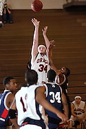 MIDDLETOWN, N.Y. - Orange County Community College men's basketball player Gorden Hurley (34) takes a shot during a game against Queensborough Community College Feb. 4, 2006. ©Tom Bushey/The Image Works..