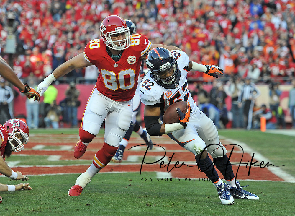KANSAS CITY, MO - DECEMBER 01:  Linebacker Wesley Woodyard #52 of the Denver Broncos intercepts a pass in the end zone against tight end Anthony Fasano #80 of the Kansas City Chiefs during the first half on December 1, 2013 at Arrowhead Stadium in Kansas City, Missouri.  (Photo by Peter G. Aiken/Getty Images) *** Local Caption *** Wesley Woodyard;Anthony Fasano