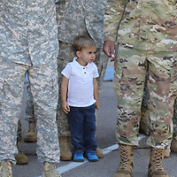 Andrew Bremseth, 2, stands in formation with his father, John, as 60 members of the 1-185th Aviation Regiment in Tupelo leave for Ft. Hood to begin a 10 month deployment to Kosovo.