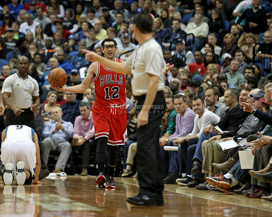 Nov 1, 2014; Minneapolis, MN, USA; Chicago Bulls guard Kirk Hinrich (12) reacts to a call during the third quarter against the Minnesota Timberwolves at Target Center. The Bulls defeated the Timberwolves 106-105. Mandatory Credit: Brace Hemmelgarn-USA TODAY Sports
