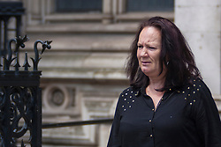 Royal Court of Justice, London, July 9th 2014. Pamela Duggan, mother of mark Duggan leaves court at lunchtime on day one of the judicial inquiry challenging the inquest verdict on Mark Duggan's shooting by police, in August 2011.