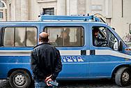Roma, 12 Maggio  2014<br /> Manifestazione dei Movimenti per il diritto all'abitare hanno contestato il Presidente del Consiglio Matteo Renzi che parlava sul palco di piazza del Popolo per la manifestazione conclusiva del Partito Democratico in vista delle elezioni europee di domenica. Attivisti dei Movimenti per la Casa sono stati  fermati dalla Polizia. Nella foto, i manifestanti fermati dalla polizia vengono portati in commissariato<br /> Rome, May 12, 2014 <br /> Manifestation of the movements for housing rights, objected to the Chairman of the Board, Matteo Renzi, who spoke on stage at the Piazza del Popolo to the closing event of the Democratic Party in the European elections on Sunday. Activists of the Movement for the House were stopped by the police.In the picture , the protesters stopped by the police are brought to the police station