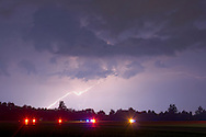 Middletown, New York - Lightning flashes above runway lights at Randall Airport during a thunderstorm on the night of Aug. 9, 2012.