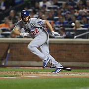 Pitcher Clayton Kershaw, Los Angeles Dodgers, batting during the New York Mets Vs Los Angeles Dodgers, game four of the NL Division Series at Citi Field, Queens, New York. USA. 13th October 2015. Photo Tim Clayton
