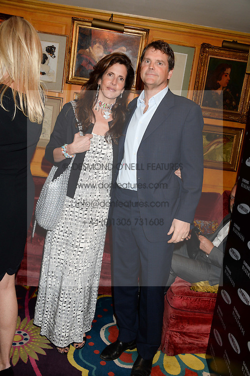 BARNABY THOMPSON and his wife CHRISTINA at the launch of Bluehouse, Samsung's Exclusive New members Club held at Annabel's, 44 Berkeley Square, London on 1st July 2013.