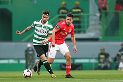 February 3, 2019 - Lisbon, Portugal - Sporting's midfielder Bruno Fernandes from Portugal (L) vies with Benfica's midfielder Gabriel of Brazil  during the Portuguese League football match Sporting CP vs SL Benfica at Alvalade stadium in Lisbon, Portugal on February 3, 2019. (Credit Image: © Pedro Fiuza/ZUMA Wire)