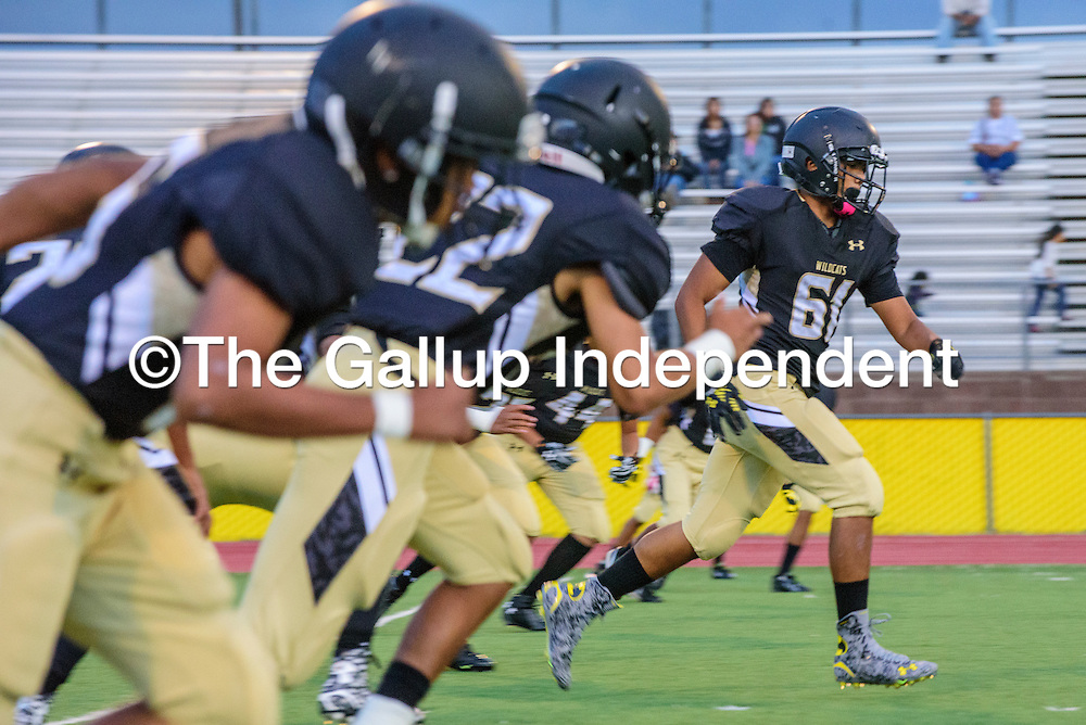 The Chinle Wildcats rush the Alchesay Falcons during a kickoff at Chinle High School Thursday.