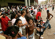 Thousands of New Orleans evacuees wait in vain for transport out of the city at the New Orleans Convention Center September 1, 2005.  Several people among the thousands of stranded hurricane evacuees have died while waiting outside the building, with no sign of imminent help on the way. REUTERS/Rick Wilking