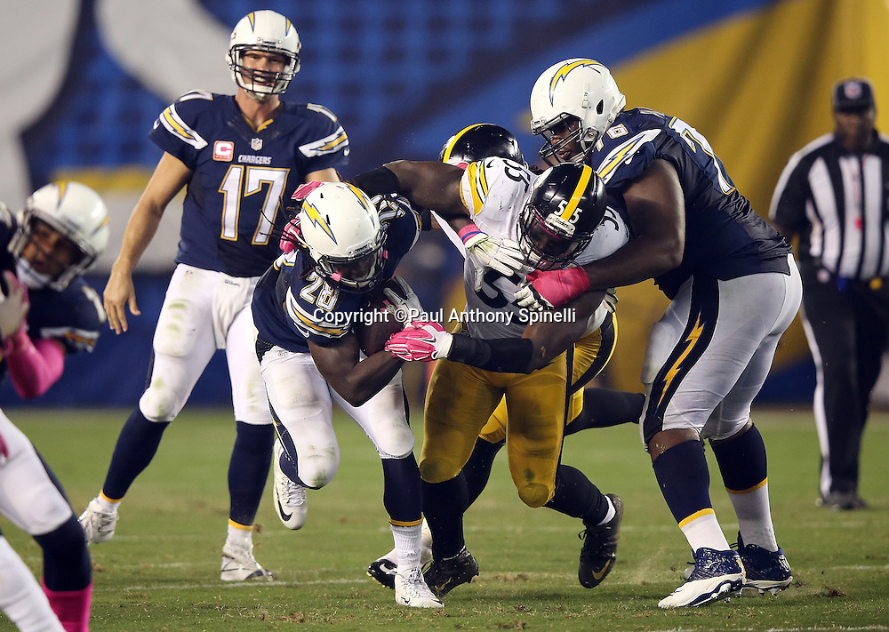 San Diego Chargers quarterback Philip Rivers (17) looks on and San Diego Chargers offensive guard D.J. Fluker (76) tries to block as San Diego Chargers running back Melvin Gordon (28) gets tackled by Pittsburgh Steelers outside linebacker Arthur Moats (55) during the 2015 NFL week 5 regular season football game against the Pittsburgh Steelers on Monday, Oct. 12, 2015 in San Diego. The Steelers won the game 24-20. (©Paul Anthony Spinelli)