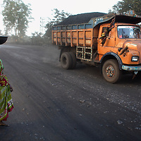 Adivasi people living and working on the fringe of the Tata coal mine at West Bokaro. Most of those employed at the mine are not from the locally displaced Adivasi communtiy so must find work in peripheral businesses of migrate in search of employment. ..Photo: Tom Pietrasik.Jharkhand, India.January 31st 2010
