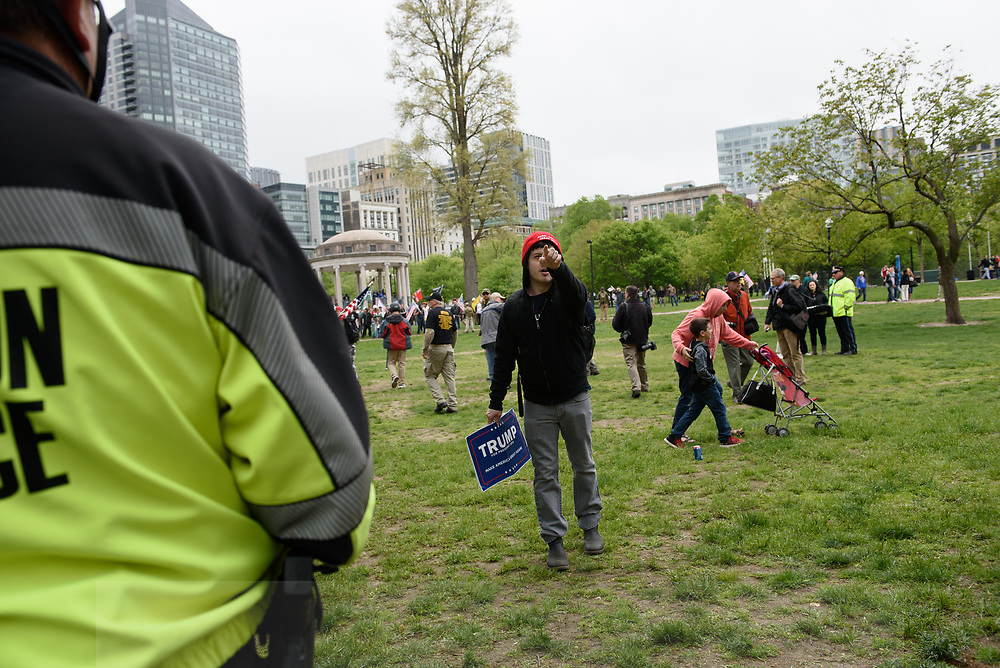 During a rally by factions of the alt-rIght, a supporter of President Trump yells at counter-protesters on the other side of a police line, May 13, 2017.<br /> Photo / Kate Flock