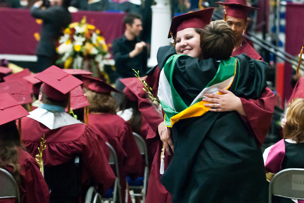 Lathan Goumas | MLive.com..A graduate hugs a faculty member during the 2012 Davison High School commencement ceremony at the Perani Arena in Flint, Mich. on Monday June 11, 2012.