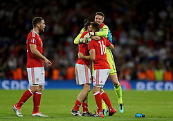 TOULOUSE, FRANCE - Monday, June 20, 2016: Wales' Sam Vokes, goalkeeper Wayne Hennessey, Gareth Bale and Joe Ledley celebrate the 3-0 victory over Russia and reaching the knock-out stage during the final Group B UEFA Euro 2016 Championship match at Stadium de Toulouse. (Pic by David Rawcliffe/Propaganda)