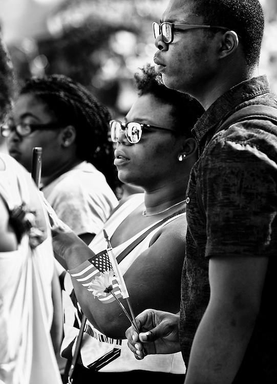 A couple with an american flag attend the memorial service for the shooting victims at Emanuel AME Church in Charleston, SC.