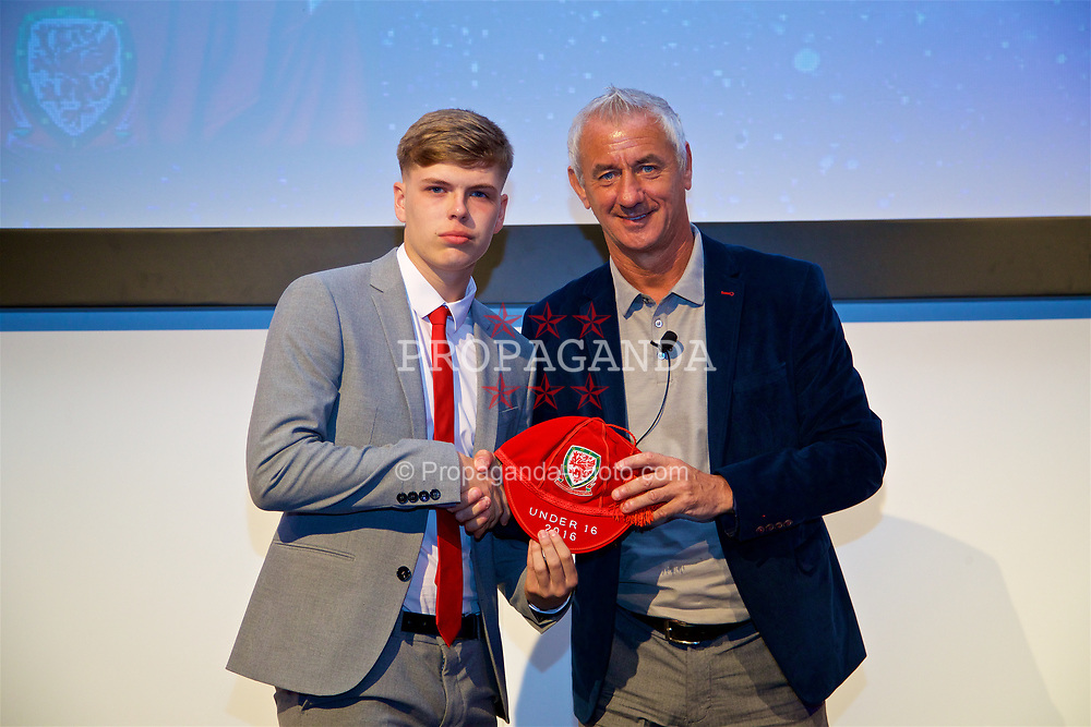 NEWPORT, WALES - Saturday, May 27, 2017: Cavan Williams receives his Under-16 Wales cap from Wales' Elite Performance Director Ian Rush at the Celtic Manor Resort. (Pic by David Rawcliffe/Propaganda)