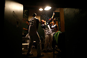 The celebration begins in the San Rafael Pacifics' clubhouse after the Pacifics' Pacific Association of Professional Baseball championship game victory over Sonoma at Albert Field in San Rafael, Calif., on Monday, Aug. 31, 2015.