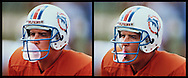 Miami Dolphins quarterback Dan Marino blows a bubble inside his helmet and it sticks to the facemask at Miami Dolphins training camp.