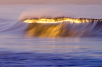 Winter sunrise reflecting off of the a wave in Ventura, California.