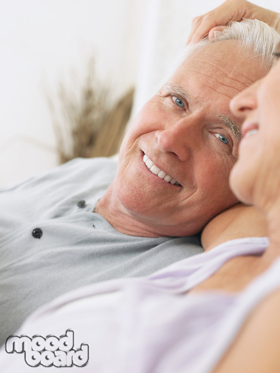 Couple embracing and smiling close-up