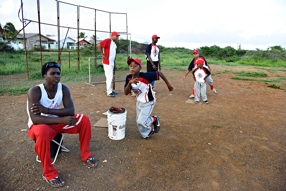 "WILLEMSTAD, CURACAO - DECEMBER 10, 2014:  The newest Yankee, Didi Gregorius, left, spends an afternoon at the makeshift ball field in Tera Kora, Curacao, where his dad, Johannes ""Didi"" Gregorius, who has retired from baseball multiple times, is now coaching. (photo by Melissa Lyttle)"