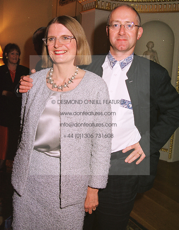 Wine expert JANCIS ROBINSON and her husband MR NICK LANDER, at a party in London on 18th May 1999.MSE 13