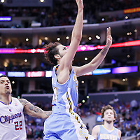 15 April 2014: Denver Nuggets guard Evan Fournier (94) goes for the layup past Los Angeles Clippers forward Matt Barnes (22) during the Los Angeles Clippers 117-105 victory over the Denver Nuggets at the Staples Center, Los Angeles, California, USA.