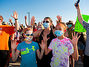 """17 JUNE 2020 - NORWALK, IOWA: Supporters of Black Lives Matter hold up their hands and chant """"hands up, don't shoot"""" during a protest in Elizabeth Holland Park in Norwalk. About 400 supporters of Black Lives Matter marched through Norwalk, IA, an upper class suburb of Des Moines Wednesday. Norwalk has a population of about 10,000 and, according to the US Census Bureau, is 97 percent white. The marchers were protesting police violence against people of color. The march was a reaction to the police killing of George Floyd in Minneapolis in May. The march was peaceful.        PHOTO BY JACK KURTZ"""