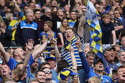 Fans celebrate AFC Wimbledon promotion to League One, after beating Plymouth Argyle Football Club 2-0 during the Sky Bet League 2 play off final match between AFC Wimbledon and Plymouth Argyle at Wembley Stadium, London, England on 30 May 2016. Photo by Stuart Butcher.