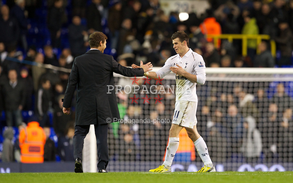 LONDON, ENGLAND - Wednesday, November 28, 2012: Tottenham Hotspur's Gareth Bale and manager Andre Villas-Boas share a joke after the 2-1 victory over Liverpool during the Premiership match at White Hart Lane. (Pic by David Rawcliffe/Propaganda)