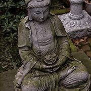 Asian work of art, Japanese or Chinese outdoor contemporary stone seated Buddha statue.