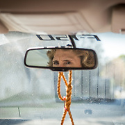 The eyes of then Charlotte mayor, Jennifer Roberts, can be seen reflected i the rearview mirror of her truck