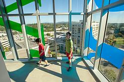 United States, Washington, Bellevue, boys in glass stairwell of Bellevue City Hall  MR