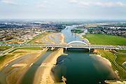 Nederland, Utrecht, Gemeente Vianen, 01-04-2016; Lekbrug Vianen (Jan Blankenbrug) met rivier de Lek en Ruimte voor de Rivier project. Uiterwaardvergraving Bossenwaard, Pontwaard en Heerenwaard, inclusief aanleg nevengeulen. Door de rivierverruiming kan bij hoog water, mede een gevolg van klimaatveranderingen, het water sneller afgevoerd.<br /> Floodplain excavation, including construction of side channels, because of climate change, in order to guarantee quicker drain off.<br /> luchtfoto (toeslag op standard tarieven);<br /> aerial photo (additional fee required);<br /> copyright foto/photo Siebe Swart