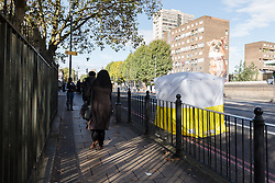 © Licensed to London News Pictures. 22/09/2016. LONDON, UK.  Police forensic tent at the scene. A man was found dead in the street following a suspected assault, near All Saints DLR station just before midnight last night.  Photo credit: Vickie Flores/LNP