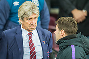 Manuel Pelligrini, Manager of West Ham FC & Mauricio Pochettino, Manager of Tottenham Hotspur FC during the EFL Cup 4th round match between West Ham United and Tottenham Hotspur at the London Stadium, London, England on 31 October 2018.
