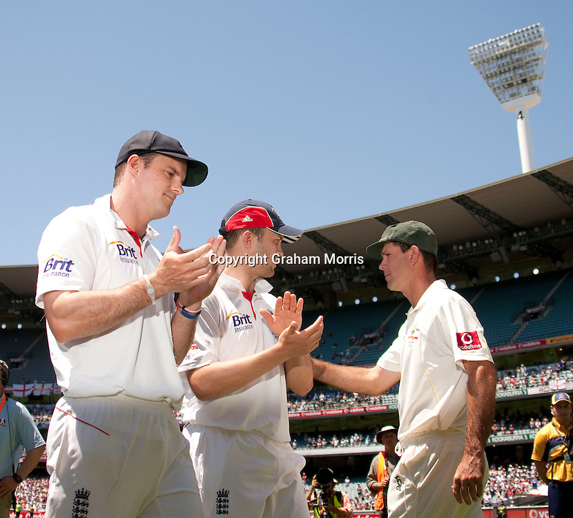 Captain Ricky Ponting (right) walks past his counterpart Andrew Strauss (left) and Jonathan Trott after losing the fourth Ashes test match between Australia and England at the MCG in Melbourne, Australia. Photo: Graham Morris (Tel: +44(0)20 8969 4192 Email: sales@cricketpix.com) 29/12/10