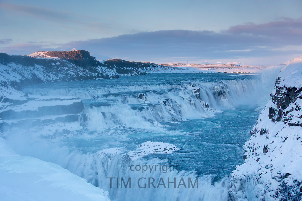 Gushing, flowing water glacial river at thundering falls of Gullfoss Waterfall in glacial landscape of South Iceland