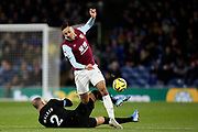 Manchester City defender Kyle Walker (2) slides in on Burnley midfielder Dwight McNeil (11)  during the Premier League match between Burnley and Manchester City at Turf Moor, Burnley, England on 3 December 2019.